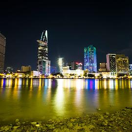 Ho Chi Minh city at night by Bảo Long - City,  Street & Park  Skylines ( skyline, building, metropolis, vietnam, cityscape, architecture, travel, saigon, ho, city, modern, landmark, urban, tower, chi, asia, night, view, light, downtown, minh, river )