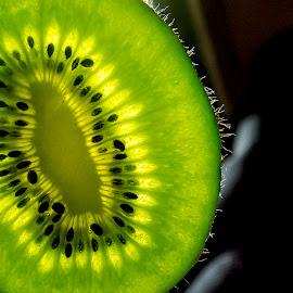Kiwi by Dace Spalviņa - Food & Drink Fruits & Vegetables ( water, fruit, droplet, fruite splash photography, kiwi, drink, fruits, drops, fruits and vegetables, kiwifruit, droplets )