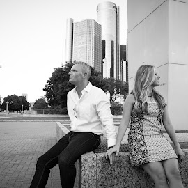 holding hands min the park by Justin Duff - People Couples ( sitting, black and white, attractive, artistic, couple, detroit, engagement, holding hands )