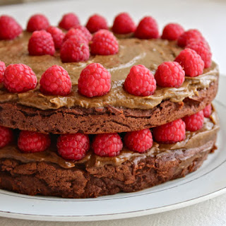Triple Layered Chocolate Cake with Thick Frosting & Fresh Raspberries