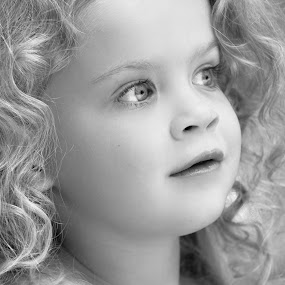 Gazing by Judy Rosanno - Black & White Portraits & People ( child, headshot, girl, gazing, child portrait, young girl, close up, curly hair, portrait, , best female portraiture )