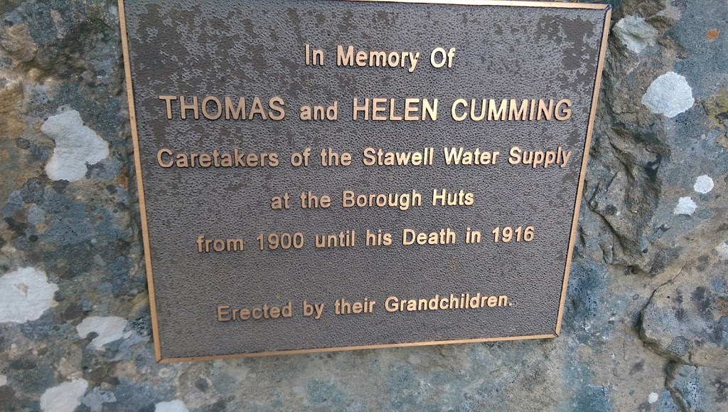 This plaque is in the Halls Gap Botanic Gardens laid in a large rock. Plaque reads: In Memory Of Thomas and Helen Cumming Caretakers of the Stawell Water Supply at the Borough Huts from 1900 until ...