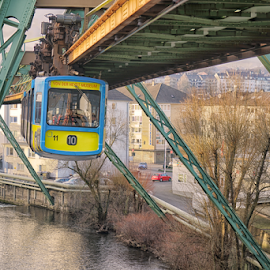 by Johannes Oehl - Transportation Trains ( water, building, structure, technology, europe, wupper, street, wuppertal, yellow, architecture, suspension railway, transportation, schwebebahn, metal, transport, rail, power, germany, construction, wsw gtw 72,  )