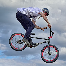 Planing On Wheels by Marco Bertamé - Sports & Fitness Other Sports ( clouds, sky, air, high, planing, bicycle )