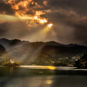 Lake Bled Island by Ceri Jones - Landscapes Mountains & Hills ( slovenia, bled, lake, sunlight, storm, rays )