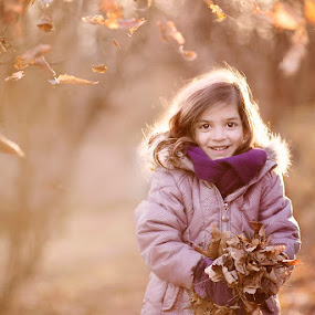 Sweet Leaves by Angel Solomon Caracciolo - Babies & Children Child Portraits ( child, girl, purple, cold, backlight, brown, leaves, coat )