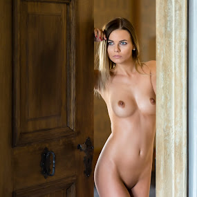 Another Door by Alex Tsarfin - Nudes & Boudoir Artistic Nude ( look, model, nude, art, door, beauty, portrait, eyes, grace, pose, blonde, female, naked, woman, light, hair )