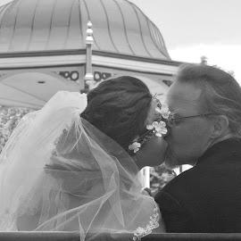 Sneaking a Kiss  by Sandy Darnstaedt - Wedding Bride & Groom