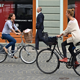 One man, two women. by Marcel Cintalan - People Street & Candids ( story, cyclists, pedestrian, slovenia, street, women, people, man, street photography )