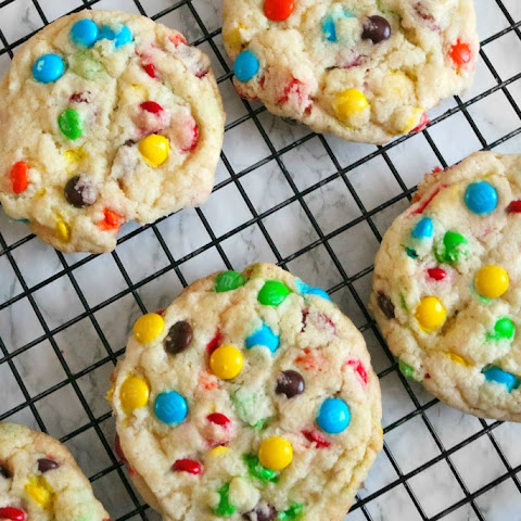 Super Soft Overloaded M&M Cookies- With A Not So Secret Ingredient!