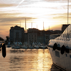 Yachts moored in Cannes by Deyan Georgiev - Landscapes Travel ( port, seafront, rigs, reflection, riviera, europe, harbor, colorful, harbour, yacht, beach, french, travel, coast, dock, city, mast, cannes, sky, shelter, quayside, idyllic, mediterranean, rigging, france, festival, resort, marina, water, hill, hobby, sport, sea, quay, cloudscape, tourism, leisure, boat, sailboat, provence, urban, yachting, touristic, vacation, blue, cinema, moored, wealth, town, cote )