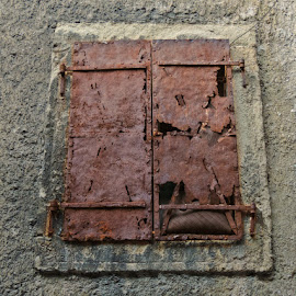 by Ksenija Bauer - Buildings & Architecture Architectural Detail ( window, old town, rust, hrvatska, historic )