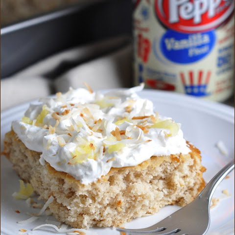 Vanilla Float Cake with Pineapple Whipped Cream and Toasted Coconut
