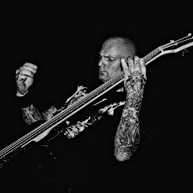 Bassist by Salvatore De Luca - People Musicians & Entertainers ( canon, music, concert, monochrome, musical, black and white, art, bassist, rock, stage, musical instrument, band, metal, performance, bass, performer, musician, festival, italy )