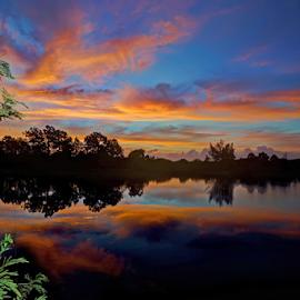 Sunrise by Rick Mann - Landscapes Sunsets & Sunrises ( clouds, water, reflection, sunrise )