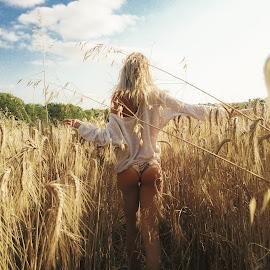 field by Daniel Jamieson - People Portraits of Women ( wheat, field, girl, nature, beautiful, booty, france, butt, travel, bikini, landscape, travel photography )