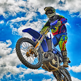 Flying High! by Marco Bertamé - Sports & Fitness Motorsports ( clouds, speed, yellow, fllying, race, noise, jump, motocross, blue, cloudy, grey, air, high )