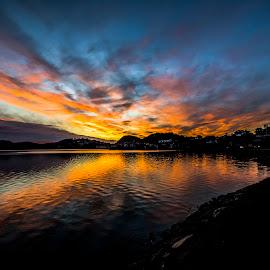 Setting sun by Hafsteinn Kröyer Eiðsson - Landscapes Sunsets & Sunrises ( clouds, reflection, waterscape, cloudscape, lake, landscape, sun, algard, norway, blue sky, sky, blue, sunset, landscape photography, landscapes, evening, golden, golden hour, skyscape )