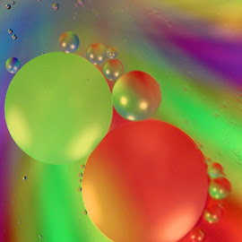 Floating by Janet Herman - Abstract Macro ( abstract, oil and water, oil drops, macro, colors, ellipses, floating, orbs )
