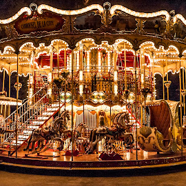 Carrousel de la Cité, Carcassonne, France by Simon Harding - City,  Street & Park  Street Scenes ( carcassonne, street, holidays, simon harding, french, fun, nikon d70, city, lights, holiday, funfair, carrousel, tungsten, fairground, merrygoround, carousel, summer, august, france, night )