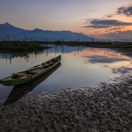Alone by Franciscus Satriya Wicaksana - Transportation Boats ( mountains, sky, sunset, lake, transportation, landscape, boat )