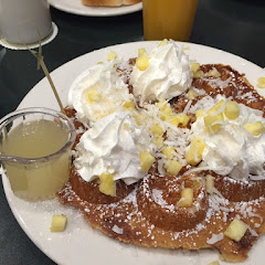 GF Hawaiian waffle with tons of pineapple and coconut and coconut syrup. Please note the little stic