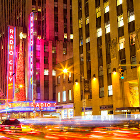 Radio City at Christmas by Rich Voninski - Travel Locations Landmarks ( radio city, neon, times square, nighttime, nyc, rain )