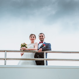 Smiling on the high railing by FIWAT Photography - Wedding Bride & Groom ( wedding photography, bride and groom )