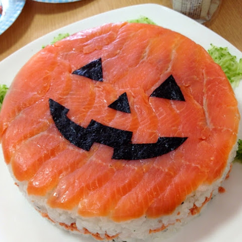 Halloween Sushi Garnished with Salmon
