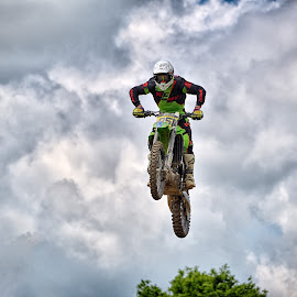 by Marco Bertamé - Sports & Fitness Motorsports ( clouds, 851, speed, green, number, race, noise, jump, flying, red, motocross, cloudy, air, grey, high )