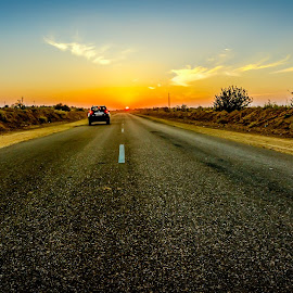 Drive into sunset by Sunayan Banerjee - Transportation Roads ( leading lines, sunsets, drive, journey, road )