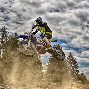Run & Dust by Marco Bertamé - Sports & Fitness Motorsports ( clouds, speed, number, yellow, race, 38, jump, noise, flying, two, motocross, blue, dust, cloudy, air, grey, high, duel )