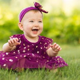 Grass and Golden Flower Dress by Marco Vergara - Babies & Children Babies ( baby girl, 1 year, grass, bokeh, park, smile )