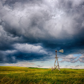 Windmill Under Storm Clouds by Kendra Perry Koski - Landscapes Weather ( wide open spaces, clouds, dakotawindsphoto.com, summer, grass, farm, hdr efex, wheat, wood, grain, abandoned, us, storm, storm cell, old, windmill, tripp county, dakota winds photography, 2018, winner, june, blue, hdr, south dakota, thunderstorm )