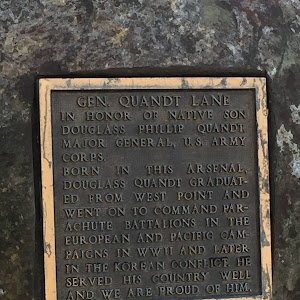 GEN. QUANDT LANE IN HONOR OF NATIVE SON DOUGLASS PHILLIP QUANDT MAIOR GENERAL, U.S ARMY CORPS. BORN IN THIS ARSENAL, DOUGLASS QUANDT GRADUAT- ED FROM WEST POINT AND WENT ON TO COMMAND PAR- ACHUTE ...