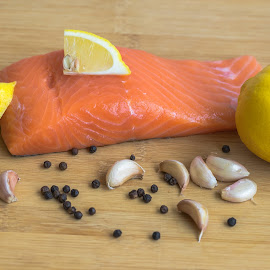 Fresh salmon and Lemon. by John Greene - Food & Drink Meats & Cheeses ( raw salmon, lemon slice, garlic, salmon, john greene, healthy food, delicious food, black pepper )