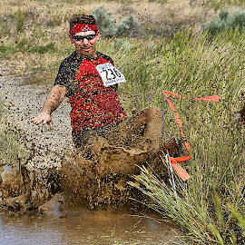 Into the mud by Gaylord Mink - Sports & Fitness Fitness ( mud, splash, runner, race )