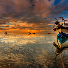 In Between by Choky Ochtavian Watulingas - Landscapes Sunsets & Sunrises ( clouds, sky, seaweeds, boats, sea, reflections, seascape, sunrise )