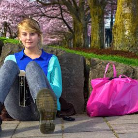 Good Idea by Eric Hanson - People Portraits of Women ( canon, park, bag, women, portrait, blossoms, city, cherry, girl, blue, trees, pink, flowers, boots )
