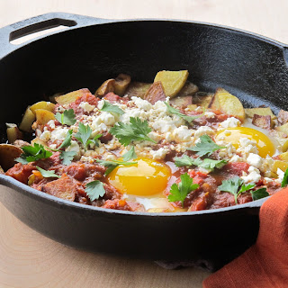 Skillet Potatoes with Eggs and Middle Eastern-Spiced Tomato Sauce