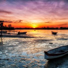 Sunset by BRYON PHILIP - Transportation Boats ( hut, sunsets, sunset, sunlight, boat, sun )