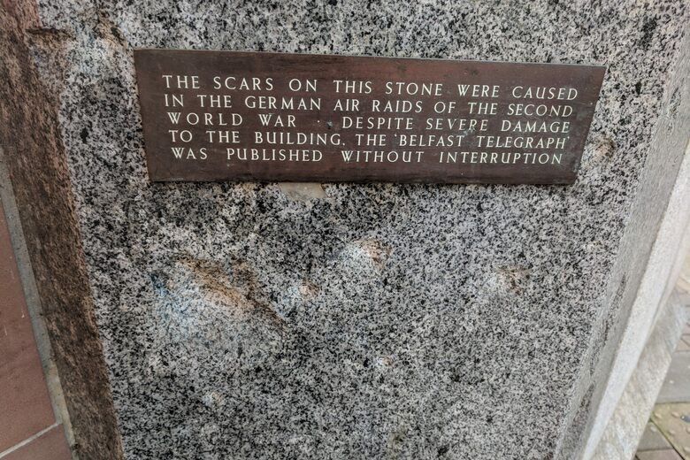 THE SCARS ON THIS STONE WERE CAUSED IN THE GERMAN AIR RAIDS OF THE SECOND WORLD WAR. DESPITE SEVERE DAMAGE TO THE BUILDING. THE BELFAST TELEGRAPH WAS PUBLISHED WITHOUT INTERRUPTION Submitted by ...