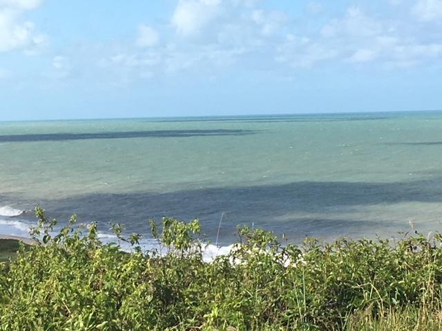 Lote 15x30 (450m²) pé na areia em Praia Bela, Conde-PB. Vista permanente para o mar.