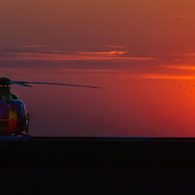 Emergency at the sunset by Gustavo Cabral - Landscapes Sunsets & Sunrises ( helicopter, accident, emergency, helipad, people, birds, urgency, paramedics, patient, medical, nurse, sunset, paramedic )