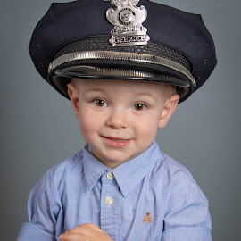 Sweetie by Dan Bartlett - Babies & Children Child Portraits ( police, hat, hope, portrait, boy, child )