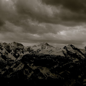 Mountains for Miles by Seamus Crowley - Landscapes Mountains & Hills ( clouds, blackandwhite, ridges, peak, snow, switzerland, storm, alps )