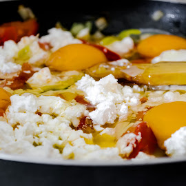 Scrambled eggs with vegetables and cheese. by Yancho Zapryanov - Food & Drink Plated Food ( dish, nobody, onions, tomato, breakfast, stuffed, cheese, pepper, scrambled, fried, brunch, yellow, yolk, egg, cooked, basil, fresh, omlette, drink, cooking, lunch, closeup, meal, burned, orange, omlet, green, coffee, white, plate, delicious, morning, pan, dinner, organic, red, herb, food )