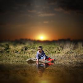 Water Boy by Una Williams Photos - Babies & Children Children Candids ( child, water, grasses, sunset, rock, boy )