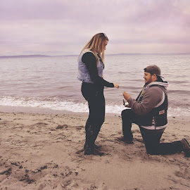 Is This For Real? by Lindsey Sides - People Couples ( love, shore, mountains, commitment, happy, proposal, shoreline, candid, couple, she said yes, beach, engagement )