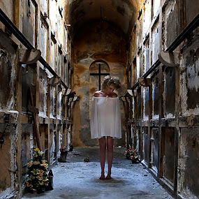 Catacombs by Ivana Miletic - People Fine Art ( girl, tombs, catacombs, ghost, ivana miletic, flowers, cross )